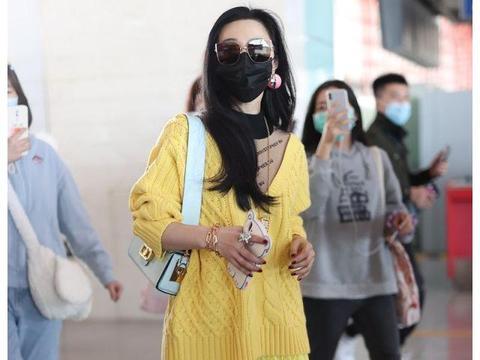 范冰冰终于高调走机场,一身柠檬黄配马丁靴,一般人都不敢尝试