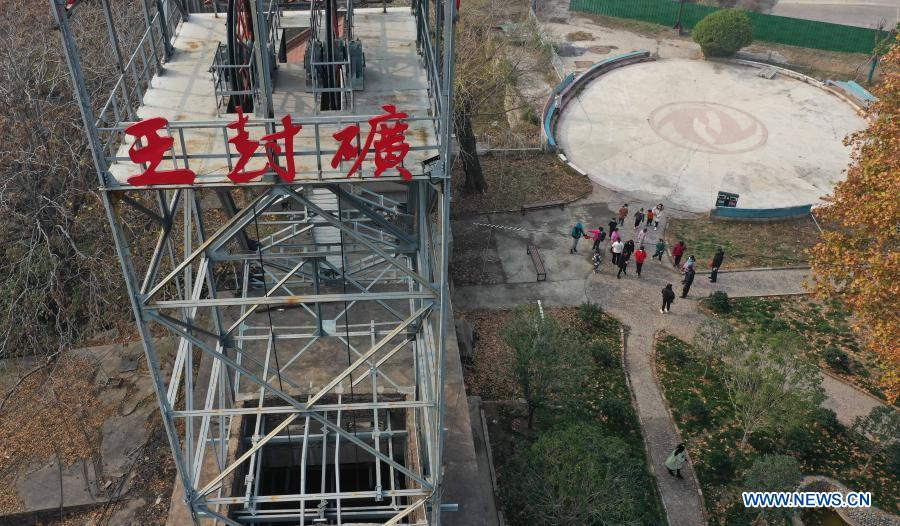 Aerial photo taken on Nov. 29, 2020 shows tourists visiting Wangfeng Mine in Zhongzhan District of Jiaozuo City, central China's Henan Province. Wangfeng Mine, located in Zhongzhan District of Jiaozuo City, was exploited in 1919 and has a history of over 100 years. In recent years, local authorities have transformed the century-old mine into a tourism and cultural park with industrial elements to make full use of the industrial relics. (Photo by Feng Xiaomin/Xinhua)