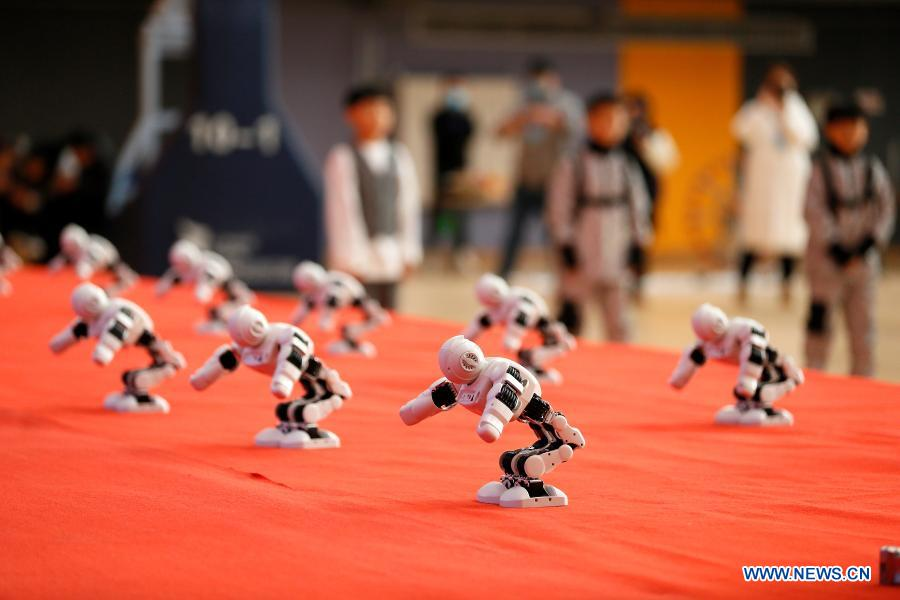 Photo taken on Nov. 29, 2020 shows robots dancing during a robotics competition for middle and primary school students in Jimo District of Qingdao, east China's Shandong Province. The robotics competition has 20 categories, attracting more than 300 middle and primary student contestants from across Jimo District. (Photo by Liang Xiaopeng/Xinhua)