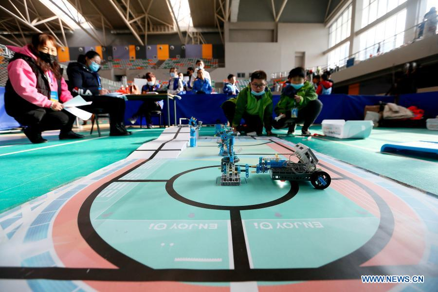 Contestants participate in a robotics competition for middle and primary school students in Jimo District of Qingdao, east China's Shandong Province, Nov. 29, 2020. The robotics competition has 20 categories, attracting more than 300 middle and primary student contestants from across Jimo District. (Photo by Liang Xiaopeng/Xinhua)