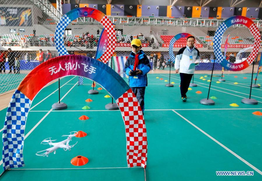 Contestants participate in a drone match during a robotics competition for middle and primary school students in Jimo District of Qingdao, east China's Shandong Province, Nov. 29, 2020. The robotics competition has 20 categories, attracting more than 300 middle and primary student contestants from across Jimo District. (Photo by Liang Xiaopeng/Xinhua)