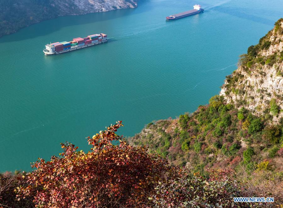 Ships sail through a section of the Xiling Gorge, one of the Three Gorges along the Yangtze River, in Zigui County of Yichang, central China's Hubei Province, Nov. 29, 2020. (Photo by Zheng Jiayu/Xinhua)