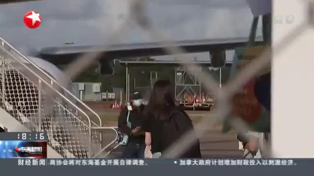 """澳大利亚:""""封国""""8个月后  首批留学生乘包机入境"""
