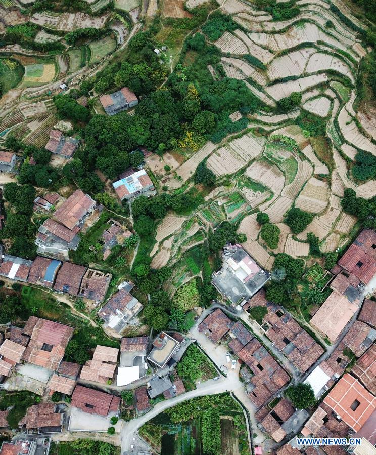 Aerial photo taken on Dec. 1, 2020 shows a view of Zhangjiao Village in Tuling Township of Quan'gang District, Quanzhou City, southeast China's Fujian Province. Zhangjiao Village, located in the northwest mountainous area of Tuling Township, has a unique scenery with its stone houses stacked on top of each other. In recent years, Quan'gang District has made full use of the characteristic resources of Zhangjiao Village to develop ecological leisure tourism and promote the construction of beautiful countryside. (Xinhua/Wei Peiquan)