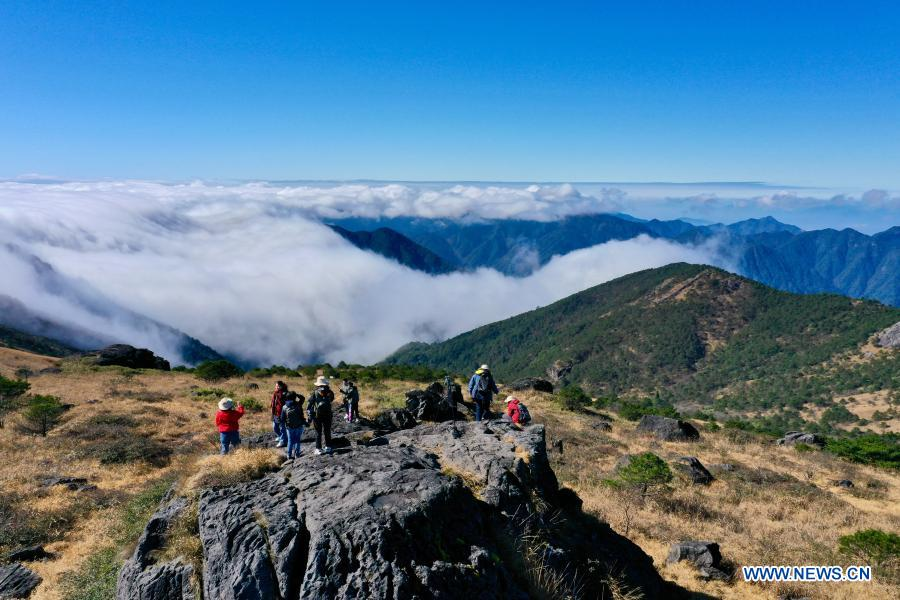 Aerial photo taken on Dec. 1, 2020 shows people having fun at Wuyishan National Park, southeast China's Fujian Province. Wuyishan National Park is one of the country's 10 pilot national parks, with 210.7 square kilometers primary forest vegetation preserved here. (Xinhua/Jiang Kehong)