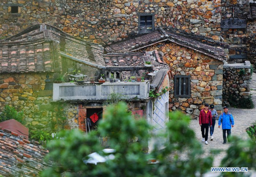 Photo taken on Dec. 1, 2020 shows a view of Zhangjiao Village in Tuling Township of Quan'gang District, Quanzhou City, southeast China's Fujian Province. Zhangjiao Village, located in the northwest mountainous area of Tuling Township, has a unique scenery with its stone houses stacked on top of each other. In recent years, Quan'gang District has made full use of the characteristic resources of Zhangjiao Village to develop ecological leisure tourism and promote the construction of beautiful countryside. (Xinhua/Wei Peiquan)
