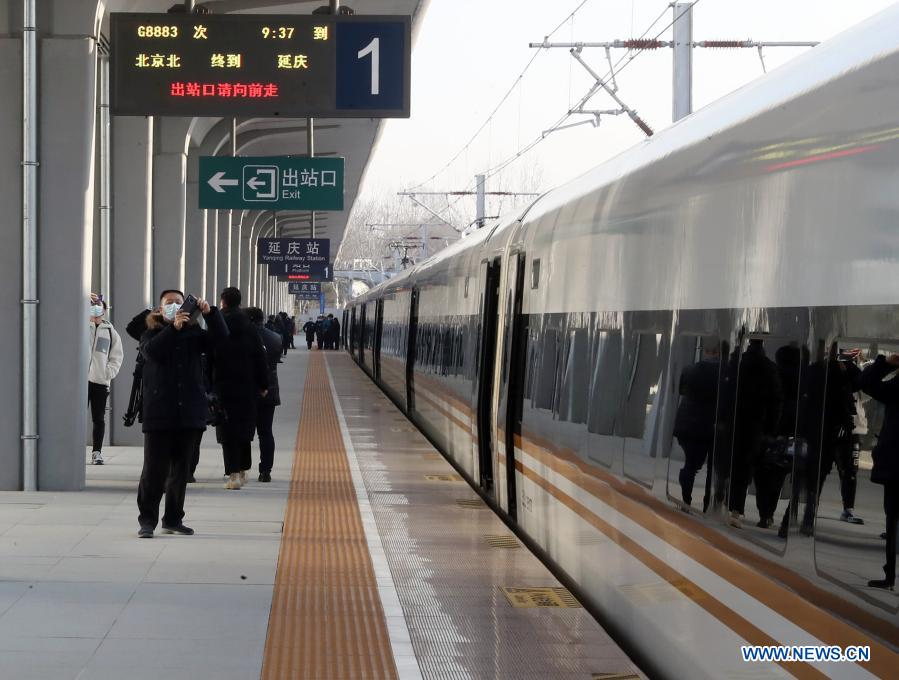 A train waits for passengers to get aboard at the Yanqing Railway Station in Yanqing District of Beijing, capital of China, Dec. 1, 2020. The Yanqing line, one of the major transport infrastructure projects for the 2022 Beijing Winter Olympics, was officially put to operation along with the new station building of the Yanqing Railway Station on Tuesday. The 9.33-kilometer line with a designed speed of 160 kilometers per hour provides a much faster connection between Yanqing and downtown Beijing. (Xinhua)