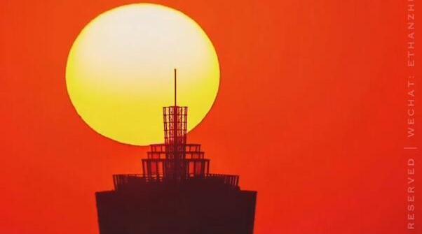 落日穿过杭州城市地标!……