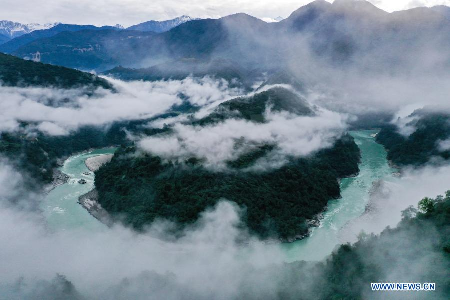 Aerial photo taken on Dec. 2, 2020 shows morning fog floating above the Yarlung Zangbo River in Medog County, southwest China's Tibet Autonomous Region. (Xinhua/Tian Jinwen)