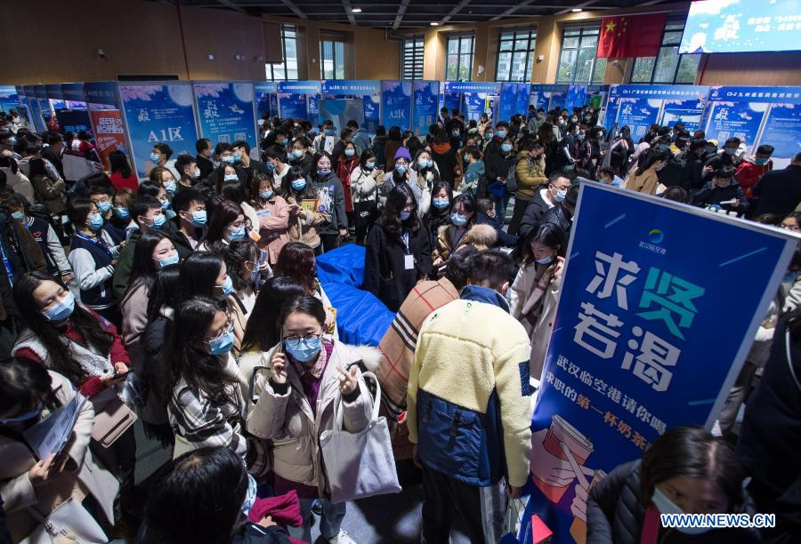 People attend a job fair at the Hongshan Gymnasium in Wuhan, central China's Hubei Province, Dec. 2, 2020. A national colleage graduates employment and entrepreneurship promotion fair kicked off here on Wednesday. Over 500,000 jobs vacancies were offered to applicants. (Xinhua/Xiao Yijiu)