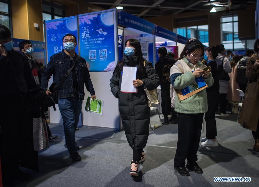 Job seekers attend a job fair at the Hongshan Gymnasium in Wuhan, central China's Hubei Province, Dec. 2, 2020. A national colleage graduates employment and entrepreneurship promotion fair kicked off here on Wednesday. Over 500,000 jobs vacancies were offered to applicants. (Xinhua/Xiao Yijiu)