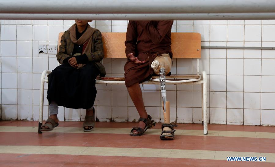 A man who lost his left leg in an explosion sits on the chair at the rehabilitation center in Sanaa, Yemen, on Dec. 2, 2020. The world observes the International Day of Persons with Disabilities on Dec. 3. (Photo by Mohammed Mohammed/Xinhua)