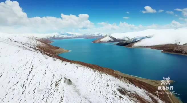 薄雪下的羊湖,童话般的世界 地点/西藏山南…………