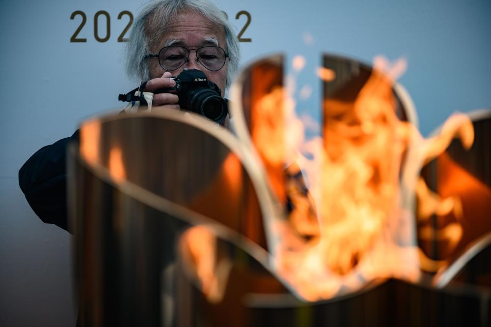 奥运延期推倒多米诺骨牌 2022冬奥遇严峻挑战?