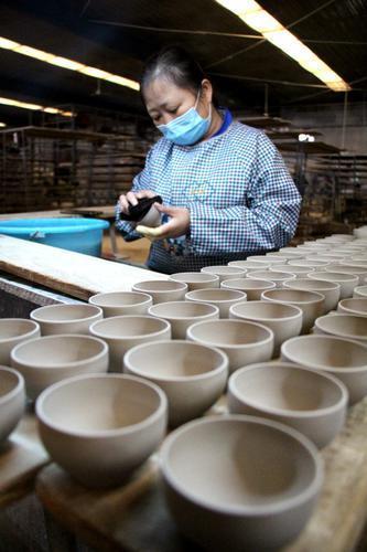 新华社聚焦复工复产 关注无棣海洋贝瓷生产