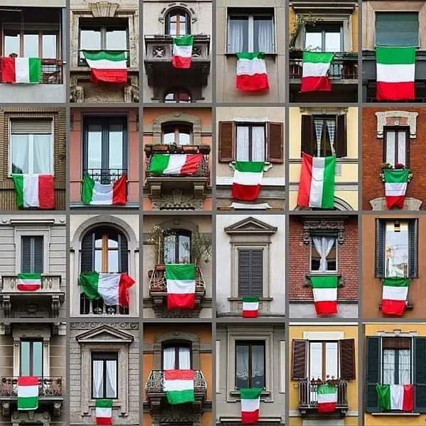意大利民众阳台上挂着意大利国旗。/图片来自推特