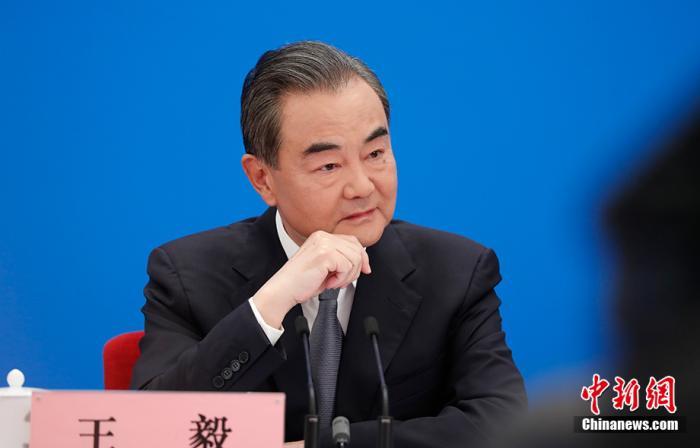 特别的外长会,王毅以喻释义答记者图片