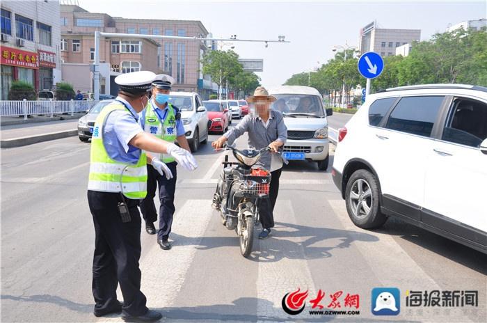 宁阳县交警大队罚教并举整治非机动车和行人交通违法