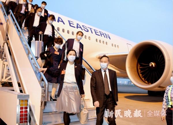 圆满完成十三届全国人大三次会议各项议程 上海代表团离京抵沪