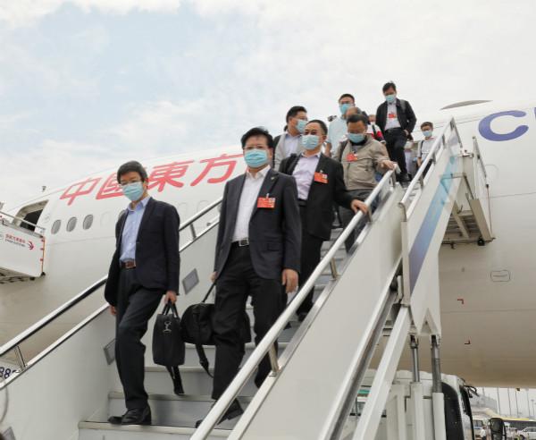 在沪全国政协委员今天上午回到上海