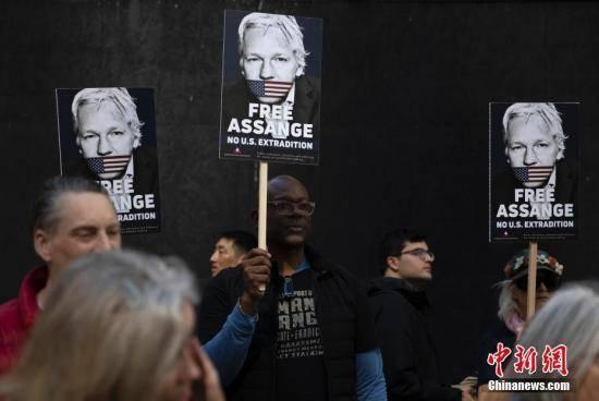 """美司法部再对阿桑奇提起指控,称其与""""匿名者""""勾连"""