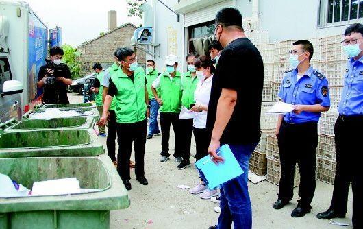青岛崂山区沙子口街道办事处开展垃圾分类执法行动