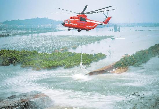 全球最大直升机空投石料堵富河溃口