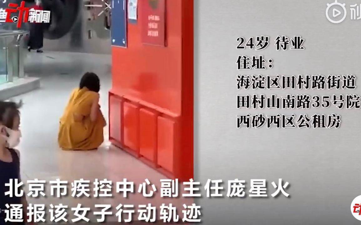 万达广场黄衣女子。图片泉源:新京报动消息截图