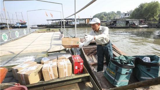 淮安唐真亚:一人双桨划出30万公里水上邮路