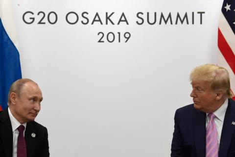 2019年6月28日,俄罗斯总统普京与美国总统特朗普在20国集团峰会期间举行会晤。(图源:美联社)