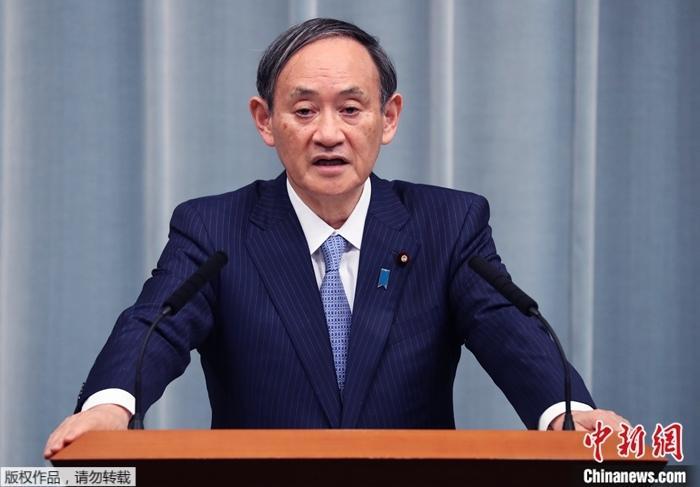 图为日本内阁官房长官菅义伟。