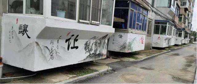 手绘墙画装点小区 文明深入百姓心中