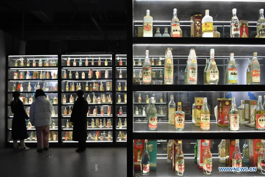 Tourists visit Zengpintang Aged Liquor Museum in Nanchang, capital of east China's Jiangxi Province, Jan. 6, 2021. Covering over 4,500 square meters, the museum with 18 exhibition halls showcases a collection of over 13,000 exhibits. (Xinhua/Wan Xiang)