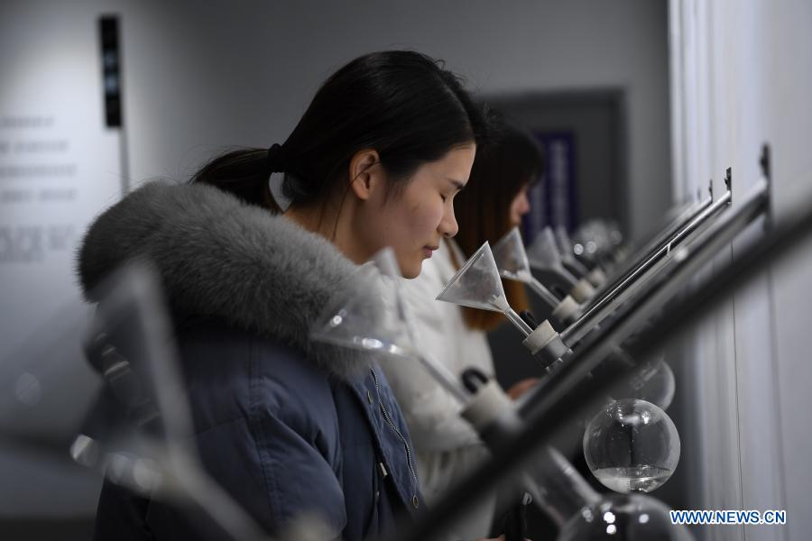 Tourists learn liquor flavors at Zengpintang Aged Liquor Museum in Nanchang, capital of east China's Jiangxi Province, Jan. 6, 2021. Covering over 4,500 square meters, the museum with 18 exhibition halls showcases a collection of over 13,000 exhibits. (Xinhua/Wan Xiang)