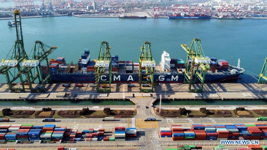 Aerial photo taken on Jan. 11, 2021 shows a container ship by the Pacific international container terminal at the Tianjin Port of north China's Tianjin Municipality. The Tianjin Port set a new record of 18.35 million twenty-foot equivalent units (TEU) for its container throughput in 2020, or a year-on-year growth of 6.1 percent. (Xinhua/Zhao Zishuo)
