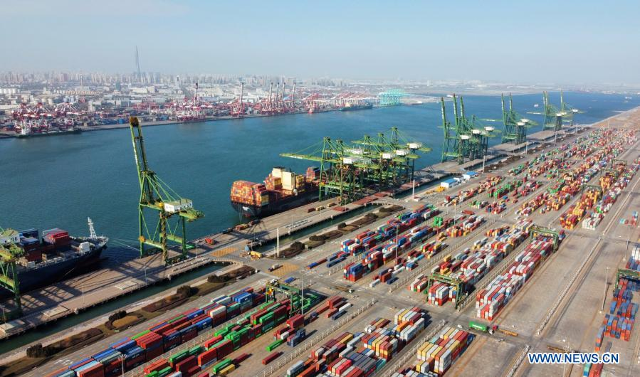 Aerial photo taken on Jan. 11, 2021 shows a view of the Pacific international container terminal at the Tianjin Port of north China's Tianjin Municipality. The Tianjin Port set a new record of 18.35 million twenty-foot equivalent units (TEU) for its container throughput in 2020, or a year-on-year growth of 6.1 percent. (Xinhua/Zhao Zishuo)