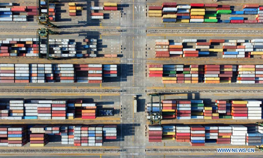 Aerial photo taken on Jan. 11, 2021 shows stacked containers at the Pacific international container terminal at the Tianjin Port of north China's Tianjin Municipality. The Tianjin Port set a new record of 18.35 million twenty-foot equivalent units (TEU) for its container throughput in 2020, or a year-on-year growth of 6.1 percent. (Xinhua/Zhao Zishuo)