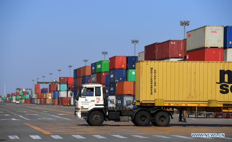 A container truck pulls through the Pacific international container terminal at the Tianjin Port of north China's Tianjin Municipality, Jan. 11, 2021. The Tianjin Port set a new record of 18.35 million twenty-foot equivalent units (TEU) for its container throughput in 2020, or a year-on-year growth of 6.1 percent. (Xinhua/Zhao Zishuo)