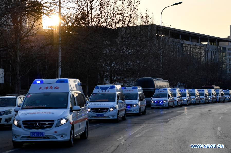 A medical team leaves the Tianjin Emergency Center in Tianjin for Hebei Province, both in north China, Jan. 11, 2021. As the second wave of medical emergency aid from Tianjin to Hebei Province, the team consists of 87 members, flanked by 20 ambulances and two other vehicles loaded with supplies for epidemic prevention and control. (Xinhua/Li Ran)