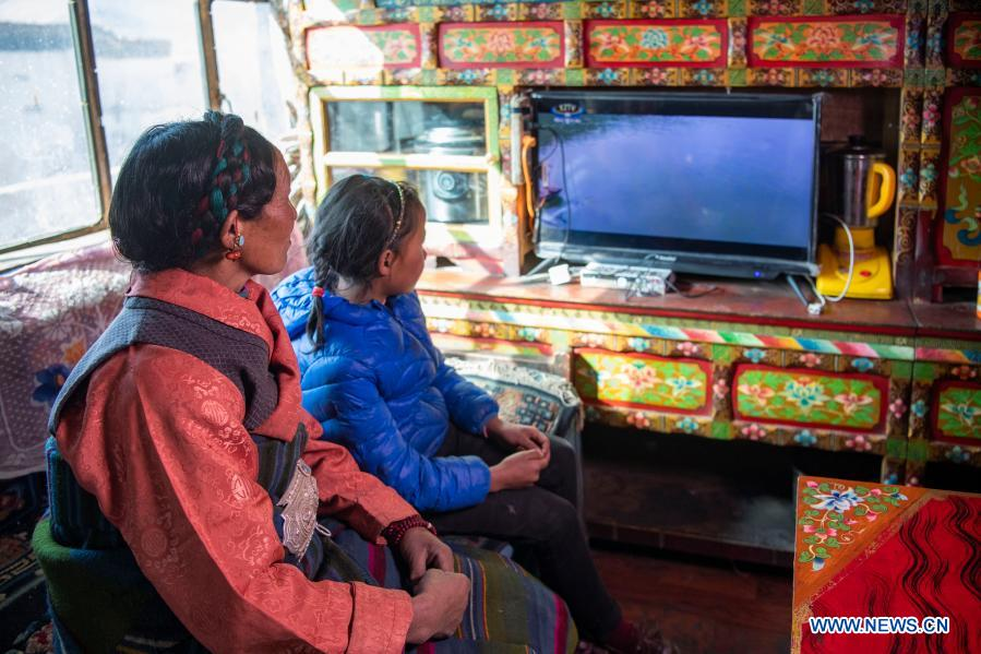 Villagers watch TV in their home in Zhaxizom Township in Xigaze, southwest China's Tibet Autonomous Region, Jan. 20, 2020. Electricity consumption across Tibet has doubled in the past five years. For those living in the region, a stable supply of electricity not only powers the home but also a better life. (Xinhua/Sun Fei)