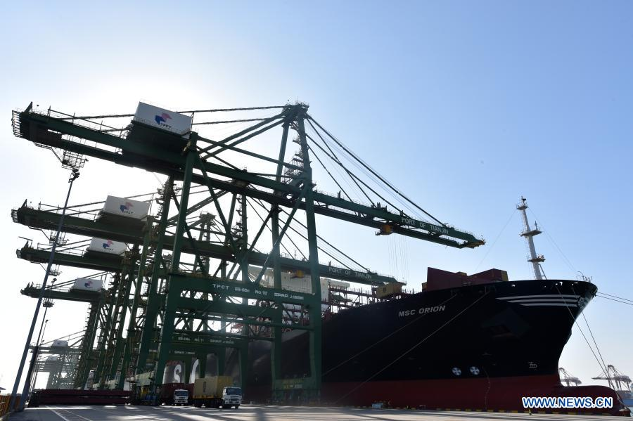 Photo taken on Jan. 11, 2021 shows a corner of the Pacific international container terminal at the Tianjin Port of north China's Tianjin Municipality. The Tianjin Port set a new record of 18.35 million twenty-foot equivalent units (TEU) for its container throughput in 2020, or a year-on-year growth of 6.1 percent. (Xinhua/Zhao Zishuo)
