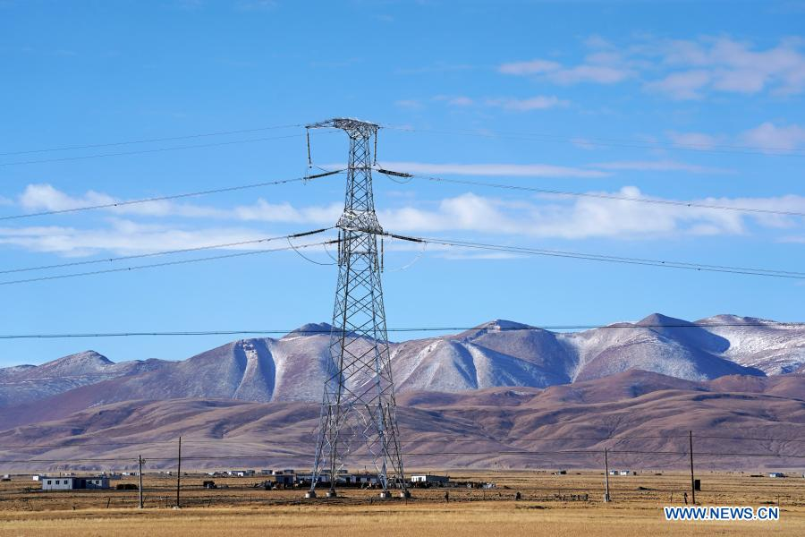 Photo taken on Nov. 29, 2020 shows a transmission tower of a power grid interconnection project in Ngari Prefecture, southwest China's Tibet Autonomous Region. Electricity consumption across Tibet has doubled in the past five years. For those living in the region, a stable supply of electricity not only powers the home but also a better life. (Xinhua/Zhan Yan)