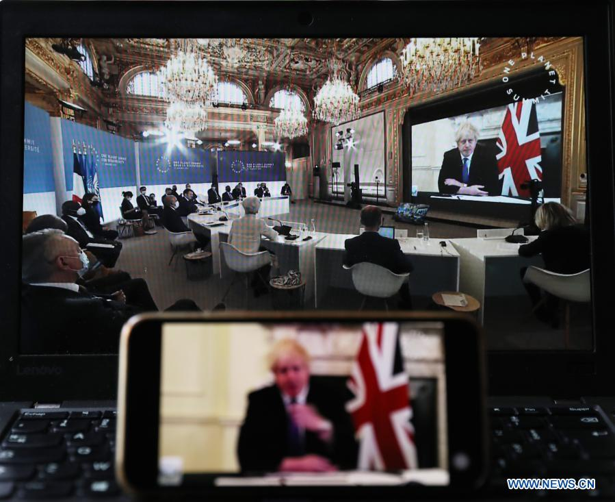 Photo taken in Paris, France, on Jan. 11, 2021 shows screens displaying British Prime Minister Boris Johnson attending the One Planet Summit for biodiversity. World leaders on Monday reiterated the urgent need for concerted global action to safeguard biodiversity and for a global governance framework on climate issues in the post-pandemic era. Organized by the French government in partnership with the UN and the World Bank, the One Planet Summit brought together world leaders to commit action to protect and restore biodiversity. (Xinhua/Gao Jing)