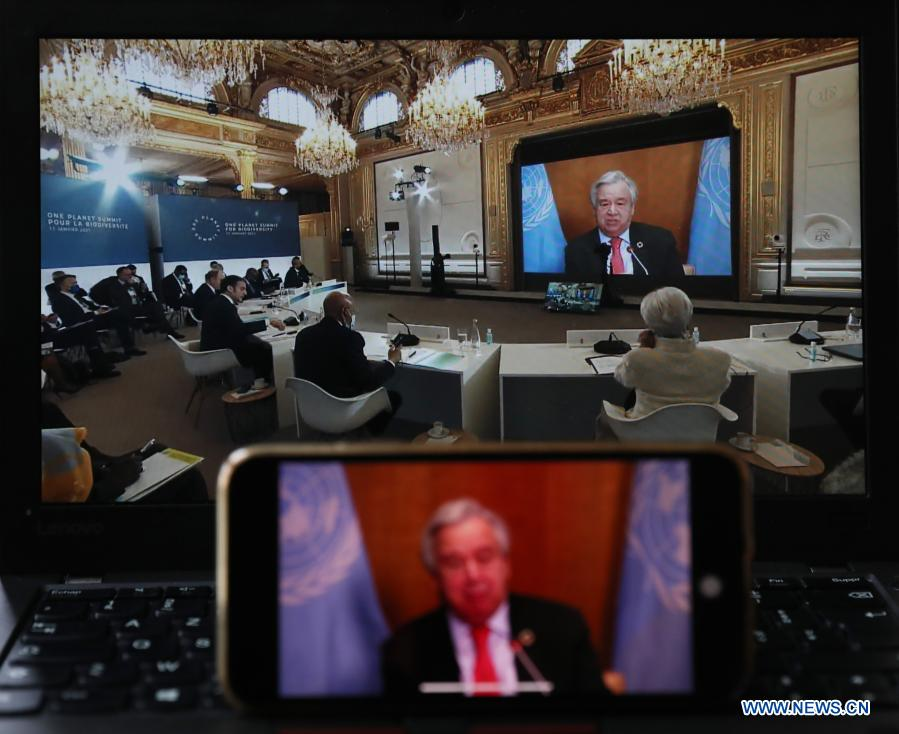 Photo taken in Paris, France, on Jan. 11, 2021 shows screens displaying UN Secretary-General Antonio Guterres addressing the One Planet Summit for biodiversity. World leaders on Monday reiterated the urgent need for concerted global action to safeguard biodiversity and for a global governance framework on climate issues in the post-pandemic era. Organized by the French government in partnership with the UN and the World Bank, the One Planet Summit brought together world leaders to commit action to protect and restore biodiversity. (Xinhua/Gao Jing)