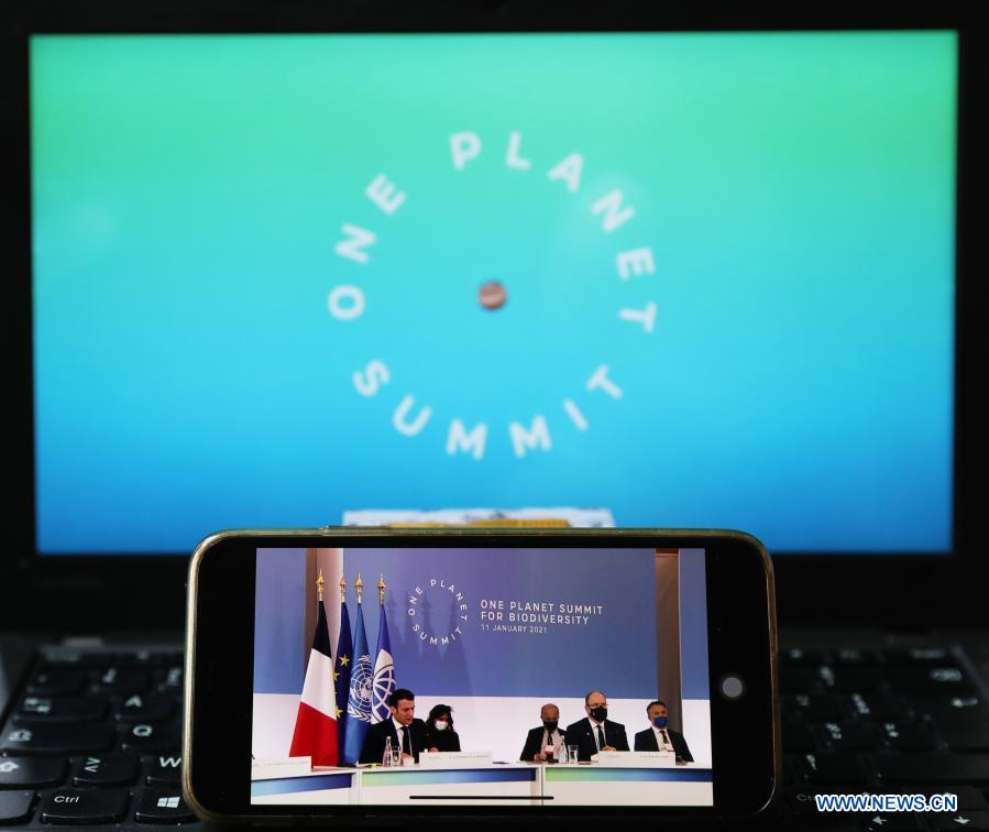 Photo taken in Paris, France, on Jan. 11, 2021 shows a screen displaying leaders attending the One Planet Summit for biodiversity. World leaders on Monday reiterated the urgent need for concerted global action to safeguard biodiversity and for a global governance framework on climate issues in the post-pandemic era. Organized by the French government in partnership with the UN and the World Bank, the One Planet Summit brought together world leaders to commit action to protect and restore biodiversity. (Xinhua/Gao Jing)