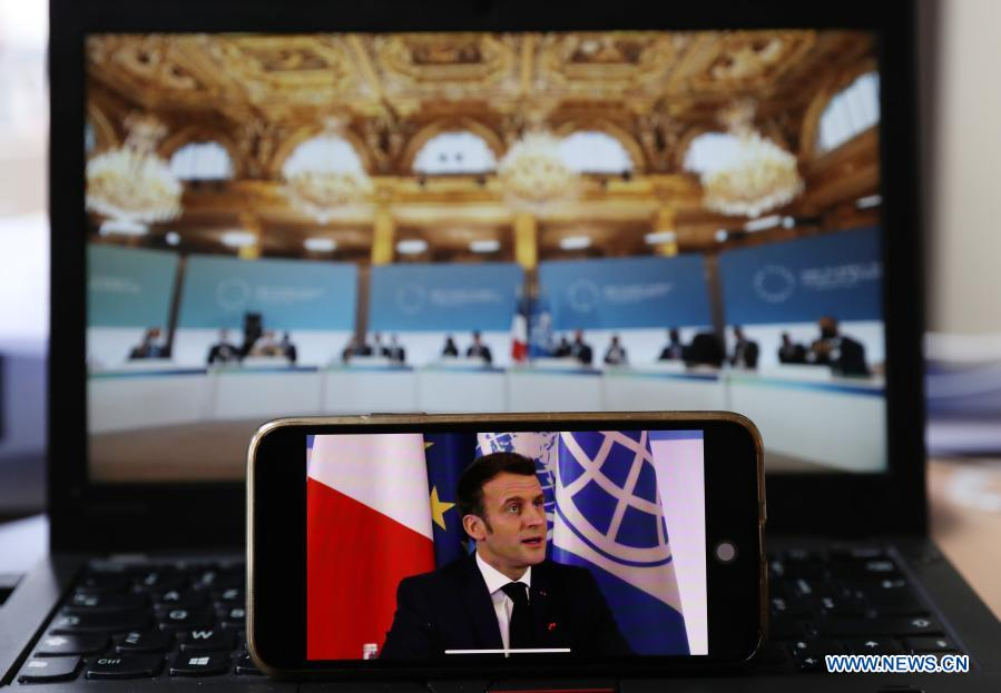Photo taken in Paris, France, on Jan. 11, 2021 shows a screen displaying French President Emmanuel Macron addressing the One Planet Summit for biodiversity. World leaders on Monday reiterated the urgent need for concerted global action to safeguard biodiversity and for a global governance framework on climate issues in the post-pandemic era. Organized by the French government in partnership with the UN and the World Bank, the One Planet Summit brought together world leaders to commit action to protect and restore biodiversity. (Xinhua/Gao Jing)