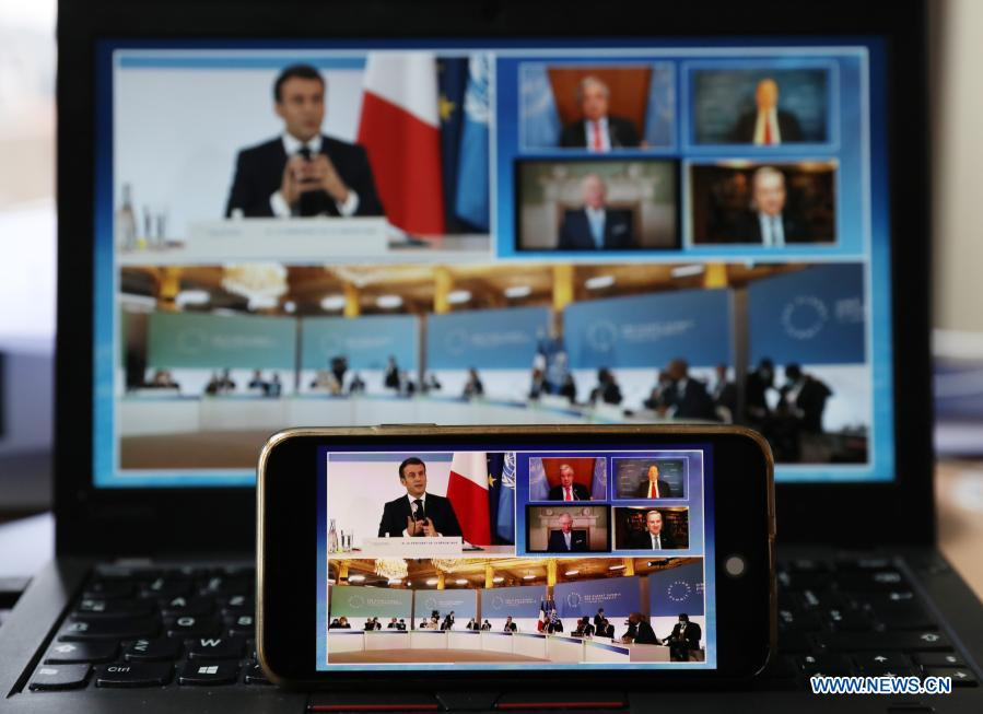 Photo taken in Paris, France, on Jan. 11, 2021 shows screens displaying leaders attending the One Planet Summit for biodiversity. World leaders on Monday reiterated the urgent need for concerted global action to safeguard biodiversity and for a global governance framework on climate issues in the post-pandemic era. Organized by the French government in partnership with the UN and the World Bank, the One Planet Summit brought together world leaders to commit action to protect and restore biodiversity. (Xinhua/Gao Jing)