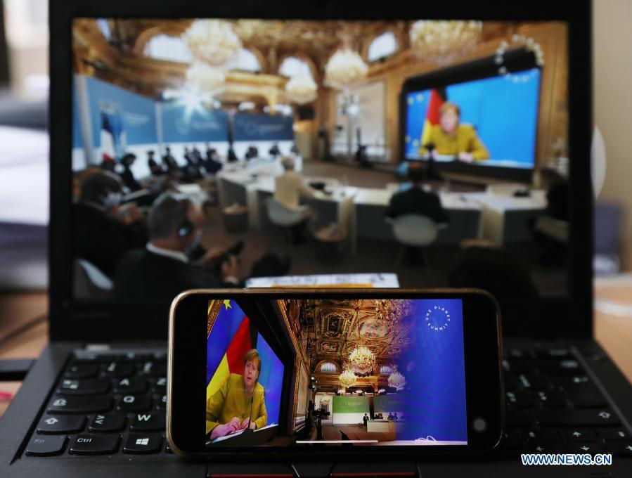 Photo taken in Paris, France, on Jan. 11, 2021 shows screens displaying German Chancellor Angela Merkel addressing the One Planet Summit for biodiversity. World leaders on Monday reiterated the urgent need for concerted global action to safeguard biodiversity and for a global governance framework on climate issues in the post-pandemic era. Organized by the French government in partnership with the UN and the World Bank, the One Planet Summit brought together world leaders to commit action to protect and restore biodiversity. (Xinhua/Gao Jing)