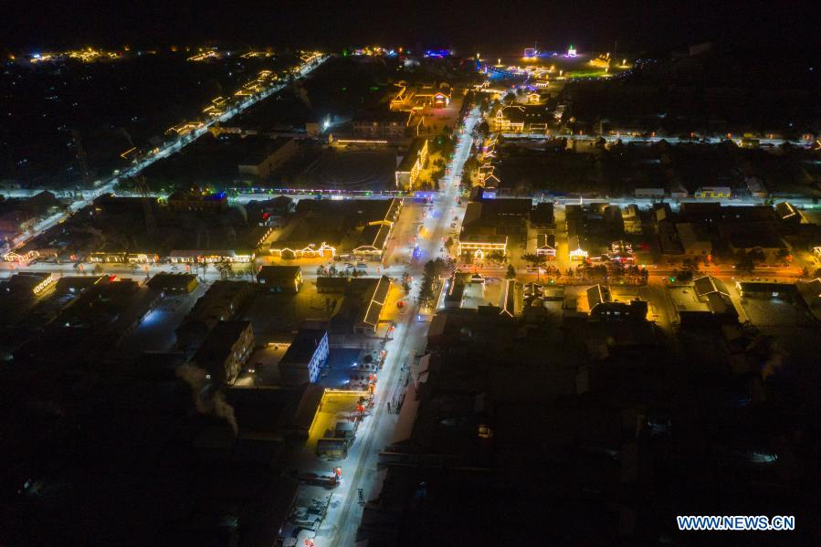 Aerial photo taken on Jan. 12, 2021 shows the night view of Beiji Village in Mohe City, northeast China's Heilongjiang Province. Beiji Village, located in Mohe City, the northernmost city in China, could only rely on small diesel generators for power supply before 2007. After connecting to the State Grid, Beiji Village set up the northernmost power supply station in China, the Beiji Power Supply Station. Director Lyu Jiansheng and meter reader Wang Shaoting are the only two staff members of the station which is in charge of more than 20 kilometers of overhead lines and 70 kilometers of buried cable lines around it. The temperature in the village often drops to below minus 40 degrees Celsius, and they patrol along the line every once in a while. In 2020, the power supply station renovated multi-functional exhibition hall and canteen, purchased kitchenware and installed bathroom.
