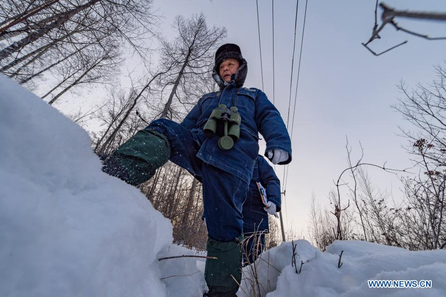Lyu Jiansheng (Front) and Wang Shaoting conduct power line patrol in the forest near Beiji Village of Mohe City, northeast China's Heilongjiang Province, Jan. 12, 2021. Beiji Village, located in Mohe City, the northernmost city in China, could only rely on small diesel generators for power supply before 2007. After connecting to the State Grid, Beiji Village set up the northernmost power supply station in China, the Beiji Power Supply Station. Director Lyu Jiansheng and meter reader Wang Shaoting are the only two staff members of the station which is in charge of more than 20 kilometers of overhead lines and 70 kilometers of buried cable lines around it. The temperature in the village often drops to below minus 40 degrees Celsius, and they patrol along the line every once in a while. In 2020, the power supply station renovated multi-functional exhibition hall and canteen, purchased kitchenware and installed bathroom.